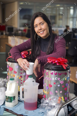 Stock Photo of Hayley Pearce the 'Tea Lady' serves an accounts employee of Save Britain Money at their Swansea call centre