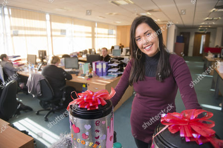 Hayley Pearce the 'Tea Lady' serves an accounts employee of Save Britain Money at their Swansea call centre