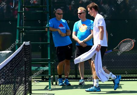 Physio Mark Bender and Jez Green (physical trainer) oversee Andy Murray