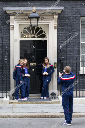 Medal winning visually impaired skier, Jade Etherington and her skiing guide Caroline Powell have their picture taken in front of the iconic door of number 10 Downing Street