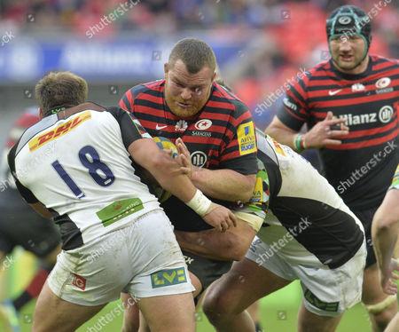 Matt Stevens of Saracens tries to get past Paul Doran Jones. Saracens v Harlequins Premiership Rugby @ Wembley Stadium. 22.3.14. Pic: Hugh Routledge