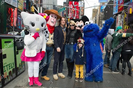Kitin Munoz and his wife Princess Kalina of Bulgaria with their son Prince Simeon Hassan in Time Square