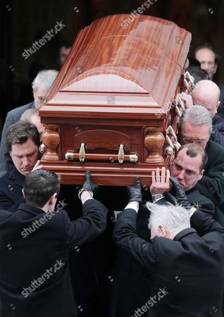 Edward and James Haughey carry the coffin