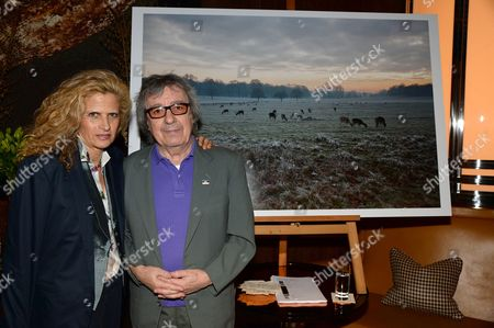"Suzanne Accosta, Bill Wyman and his work titled ""Richmond Park, Surrey, at sunset (December 2012)"""