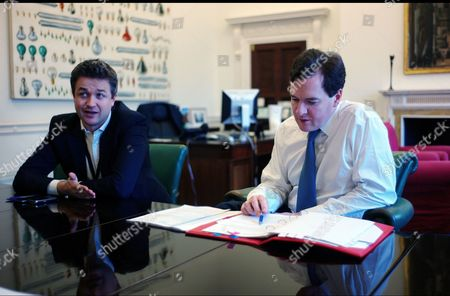 Chancellor of the Exchequer George Osborne preparing for the 2012 Budget with his Chief of Staff Rupert Harrison in his office in the treasury