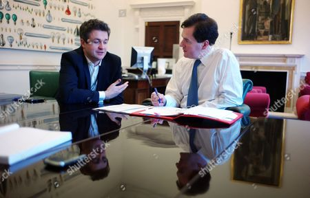 Stock Picture of Chancellor of the Exchequer George Osborne preparing for the 2012 Budget with his Chief of Staff Rupert Harrison in his office in the treasury