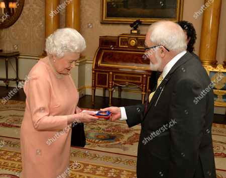 Queen Elizabeth II presents Mr Douglas Dunn with the Queen's Gold Medal for Poetry
