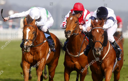 Graphic and Seb Sanders (right) winning The William Hill In The App Store Doncaster Mile from Fencing (left)