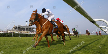 Graphic and Seb Sanders (right) winning The William Hill In The App Store Doncaster Mile