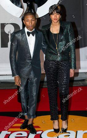 Pharell Williams and Helen Lasichanh