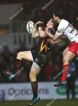 Stock Image of Dragons' Dan Evans and Edinburgh's Harry Leonard compete for the ball