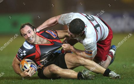 Dragons' Will Harries is tackled by Edinburgh's James Hilterbrand