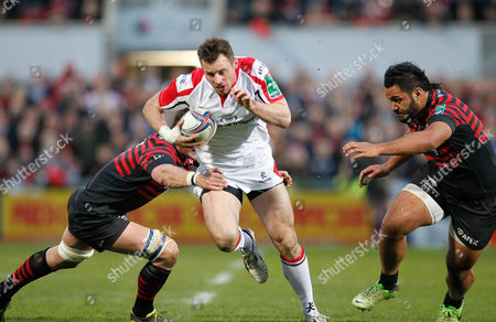 05.04.14 - Ulster v Saracens - Heineken Cup - Tommy Bowe of Ulster takes on Mouritz Botha and Billy Vunipola of Saracens.  (c) Huw Evans Agency.