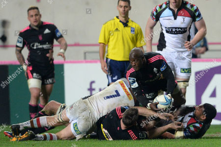 Paris player's Djibril Camara in middle fights with the ball against Harlequins players's Chris Robshaw (L) and Jordan Turner-Hall during the Rubgy Amlin Challenge Cup, Quater-finals, Stade Francais Paris vs Harlequins at Stade Jean Bouin, Paris, France  - 04/04/2014