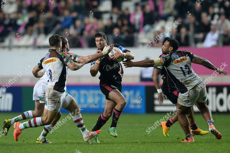Paris player's Morne Steyn in middle fights with the ball against Harlequins players's Nick Easter (L) and Jordan Turner-Hall during the Rubgy Amlin Challenge Cup, Quater-finals, Stade Francais Paris vs Harlequins at Stade Jean Bouin, Paris, France  - 04/04/2014