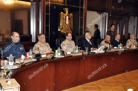 Stock Picture of Egypt's interim President Adly Mansour meets with Egypt's army chief Field Marshal Abdel Fattah al-Sisi (seated next to Mansour) and military leaders