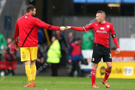 Joe Ledley of Crystal Palace and Craig Bellamy of Cardiff City shake hands at full time