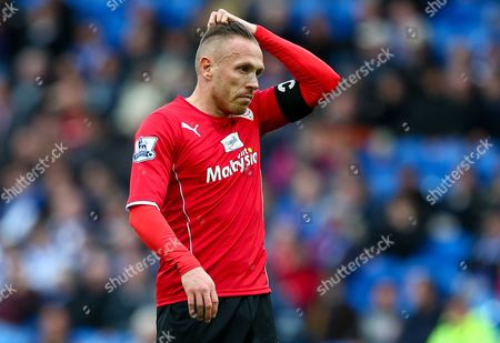 Craig Bellamy of Cardiff City shows a look of dejection