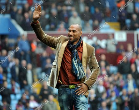 Ex Aston Villa player John Carew waves to the fans in the holte end during the half-time interval