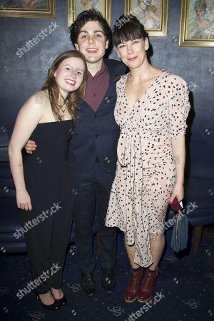 Stock Image of Rebecca Benson (Eli), Martin Quinn (Oskar) and Susan Vidler (Oskar's Mum)