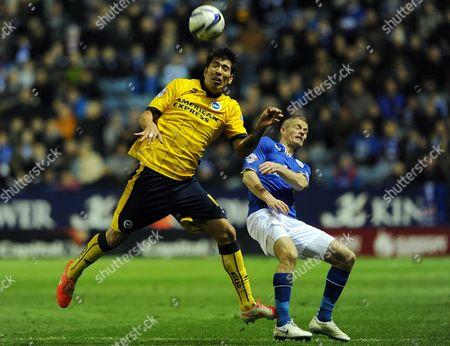 Leonardo Araujo Ulloa of Brighton & Hove Albion and Paul Konchesky of Leicester City