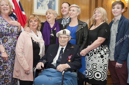 The Chief Of Defence Staff General Sir David Richards Presented Commander Eddie Grenfell Rn (retd) The Lead Campaigner And Veteran Of The Arctic Convoys With The First Arctic Star Medal At A Special Ceremony At Portsmouth's Guildhall For His Service During World War Ii On The Arctic Convoys. Pictured From Left ; Sue Dixon (friend Of Family) Jane Mccaughan (friend Of Family) Trudie Grenfell (daughter) Andy Dixon(grand-daughter's Partner) Michelle Grenfell (grand-daughter) Erica Middlecombe (daughter) And Henry Middlecombe (grandson) . Commander Eddie Grenfell Rn (retd) Seated In Wheelchair. (commander Eddie Grenfell Died 28th June 2013).