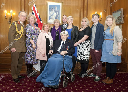 The Chief Of Defence Staff General Sir David Richards Presented Commander Eddie Grenfell Rn (retd) The Lead Campaigner And Veteran Of The Arctic Convoys With The First Arctic Star Medal At A Special Ceremony At Portsmouth's Guildhall For His Service During World War Ii On The Arctic Convoys. Pictured From Left ; Gen. Sir David Richards Sue Dixon (friend Of Family) Jane Mccaughan (friend Of Family) Trudie Grenfell (daughter) Andy Dixon (grand-daughter's Partner) Michelle Grenfell (grand-daughter) Erica Middlecombe (daughter) Henry Middlecombe (grandson) And Eloise Middlecombe (grand-daughter). Commander Eddie Grenfell Rn (retd) Seated In Wheelchair. (commander Eddie Grenfell Died 28th June 2013).