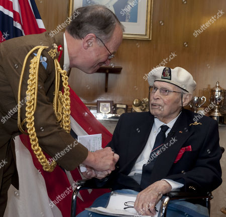 The Chief Of Defence Staff General Sir David Richards Presented Commander Eddie Grenfell Rn (retd) The Lead Campaigner And Veteran Of The Arctic Convoys With The First Arctic Star Medal At A Special Ceremony At Portsmouth's Guildhall For His Service During World War Ii On The Arctic Convoys. (commander Eddie Grenfell Died 28th June 2013).