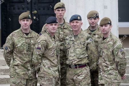 Editorial image of Ministry Of Defence Operational Honours. Left To Right Lance-corp Lawrence Kayser The Royal Anglian Regiment Captain Michael Dobbin Greadier Guards Lance-corporal Stephen Shaw Royal Army Medical Corps Captain John Scarlett Colstream Guards And Sergea