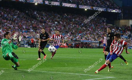 David Villa of Atletico Madrid and Barcelona goalkeeper Jose Manuel Pinto