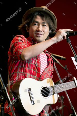 Japanese singer-songwriter Naoto Inti Raymi performs