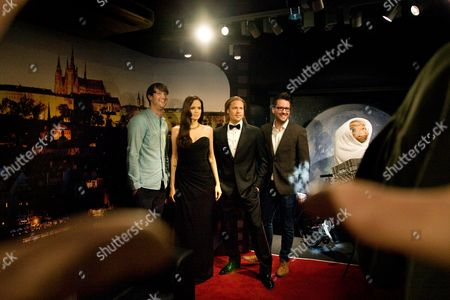 Madame Tussauds' senior sculptor Dave Gardner (L) and Richard Jones (R), global external relations manager for Madame Tussauds Attractions, pose with wax figure of actress Angelina Jolie and actor Brad Pitt displayed during a press preview of the 'Madame Tussauds Prague'