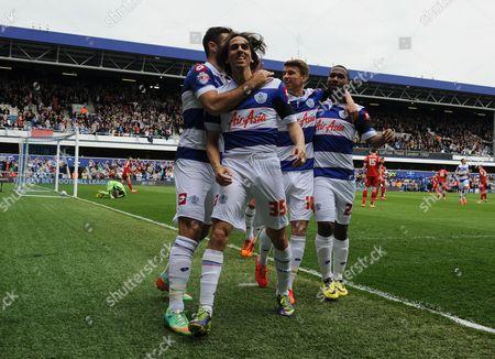 Yossi Benayoun of QPR celebrates scoring the opening goal of the game