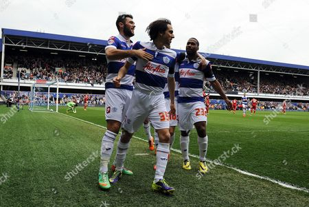 Yossi Benayoun of QPR celebrates scoring the opening goal of the game with team mates Charlie Austin and Junior Hoilett