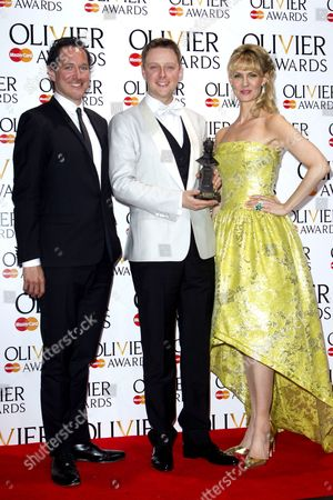 Stephen Ashfield accepts the award for Best performance in a Supporting Role in a Musical for The Book of Mormon, presented by Bertie Carvel and Leigh Zimmerman