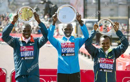 Stanley Biwott 2nd, Wilson Kipsang 1st and Tsegaye Kebede 3rd, winners of the men's elite race