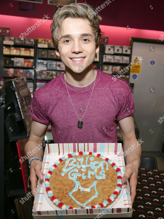 Elyar Fox with 'A Billion Girls' cookie from fans
