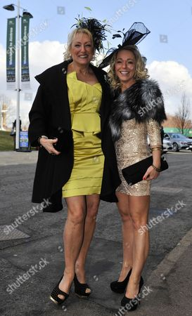 Editorial image of The Grand National Race Meeting At Aintree Racecourse Liverpool Merseyside. Pic Shows:- Racegoers Michelle (r) And Sheila Shaw From Liverpool.