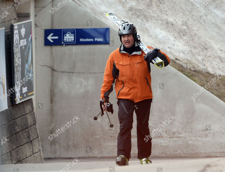 Stock Image of Tory Mp Nick Hurd The Minister For Civil Society Strolls Through Klosters With His Second Wife Lady Clare Kerr - Seventeen Years His Junio. The Couple Were On A Skiing Break With Her Father Michael Ancram The Former Conservative Party Chairman.
