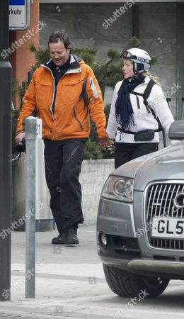 Stock Photo of Tory Mp Nick Hurd The Minister For Civil Society Strolls Through Klosters With His Second Wife Lady Clare Kerr - Seventeen Years His Junio. The Couple Were On A Skiing Break With Her Father Michael Ancram The Former Conservative Party Chairman.