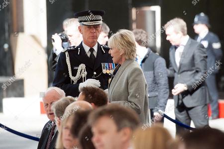 Metropolitan Police Commissioner Sir Bernard Hogan-Howe speaks with Geraldine Lynton Edwards