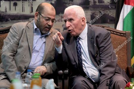 Hamas deputy leader Mousa Mohammed Abu Marzook speaks with the head of the delegation of the Palestine Liberation Organisation (PLO) Azzam al-Ahmad