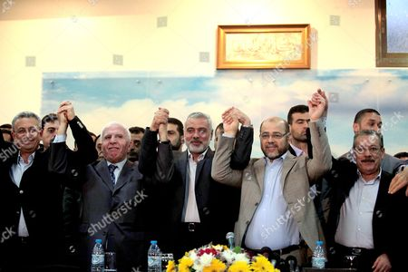 Stock Photo of Senior Fatah official Azzam Al-Ahmed, head of the Hamas government Ismail Haniyeh and Hamas deputy leader Mousa Mohammed Abu Marzook