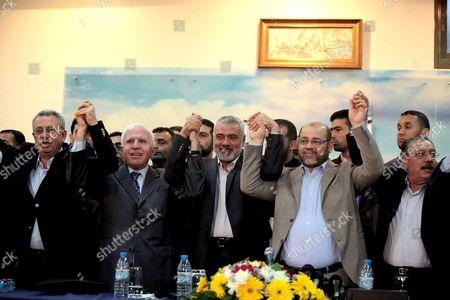Senior Fatah official Azzam Al-Ahmed, head of the Hamas government Ismail Haniyeh and Hamas deputy leader Mousa Mohammed Abu Marzook