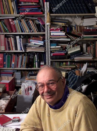 RABBI LIONEL BLUE IN HIS EXTREMLEY CLUTTERED OFFICE AT HIS NORTH LONDON HOME