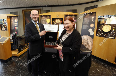 Stock Picture of Shane Bissett of the Royal Mint presents Edwina Hart of the Welsh Assembly with a gift
