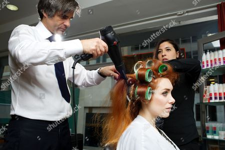 Stock Image of Joanna Della Ragione and celebrity hairdresser Julien Farel at his exclusive Salon on Madison Avenue