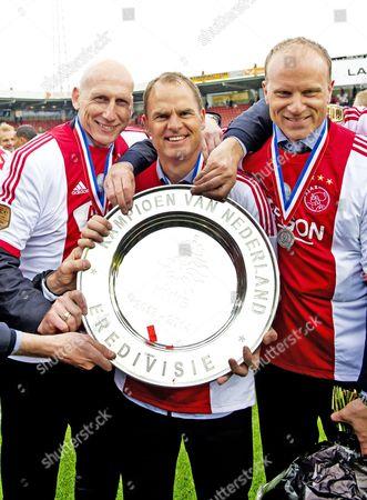 Jaap stam, Frank De Boer and Dennis Bergkamp with the trophy