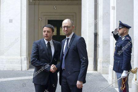 Ukraine Prime Minister Arseniy Yatsenyuk (R) meets Italian Prime Minister Matteo Renzi
