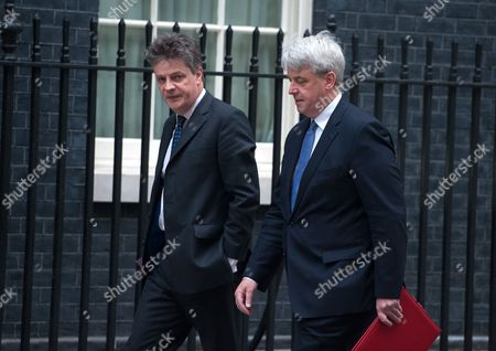 Leader of the House of Lords Lord Hill (L) and the Leader of the House of Commons Andrew Lansley (R) arrive at 10 Downing Street for a Cabinet meeting